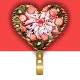 Heart shape full of cake decor Royalty Free Stock Photos