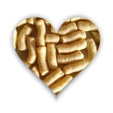 Heart shape full of corn puffs Royalty Free Stock Images