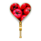 Heart shape full of tomatoes with stem Royalty Free Stock Photography