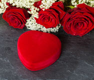 Heart Shape Gift Box, and red Roses bouquet Royalty Free Stock Photography