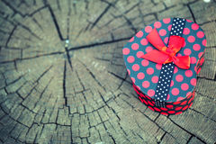 Heart Shape of Gift Box on Wooden Trunk Stock Image