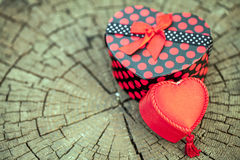 Heart Shape of Gift Box on Wooden Trunk Stock Photo