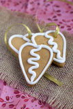 Heart shape gingerbread Cookie on sacking. With golden ribbon Royalty Free Stock Images