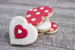 Heart shape gingerbread on wooden background Stock Photos