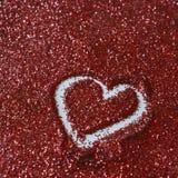 Heart shape on glitter royalty free stock photos
