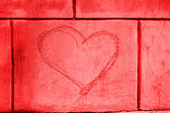 Heart shape graffiti on wall Stock Images