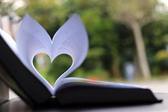 Heart Shape with Green Background. A Heart Shape as Formed by Two Folding Pages of a Book Royalty Free Stock Images