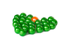 Heart shape of green and orange beads Royalty Free Stock Images
