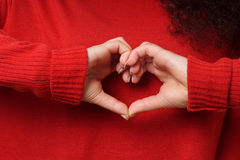 Heart shape hand sign Valentines Day concept. Love and valentine's day concept girl making heart shape hand sign Stock Photo