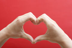 Heart shape with hands Stock Photography