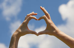 Heart shape hands Stock Photography