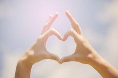 Heart shape hands Stock Photography