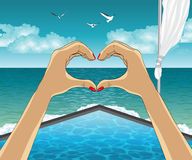 Heart shape from the hands on Luxury resort. Heart shape from the hands. A person restsing on Luxury resort. Tropical paradise Royalty Free Stock Photography