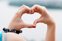 Heart shape of hands Stock Image