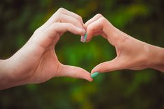 Heart shape with hands Stock Photos