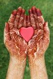 Heart shape in henna hands Royalty Free Stock Photos