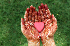 Heart shape in henna hands Royalty Free Stock Images