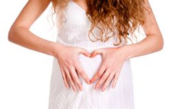 Heart shape on her pregnant belly Royalty Free Stock Photography