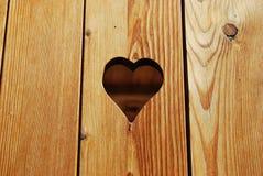 Heart shape hole Stock Photo