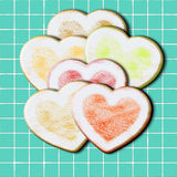 Heart shape home made cookies. On a blue tile Royalty Free Stock Photography