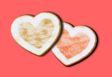 Heart shape home made cookies. Against a pink background Royalty Free Stock Photo
