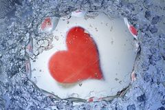 Heart shape in ice Stock Photo