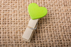 Heart shape icon  attached to Clothespin Stock Photos