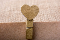 Heart shape icon  attached to Clothespin Royalty Free Stock Image