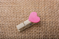 Heart shape icon  attached to Clothespin Royalty Free Stock Photos