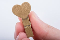 Heart shape icon  attached to Clothespin Stock Images