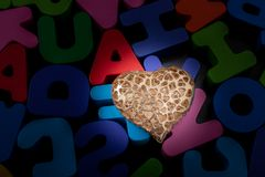 Heart shape icon and Colorful wooden Letters royalty free stock photography