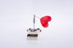 Heart shape icon on a typewriter. On white background stock image