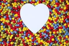 Heart shape inside smarties Stock Photos