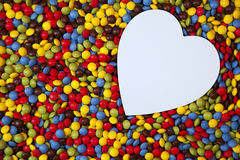 Heart shape inside smarties Royalty Free Stock Images