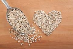 Heart shape jobs tears with transfer scoop Stock Photo