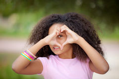 Heart shape kid. Young african american kid making heart shape with hands Stock Photos