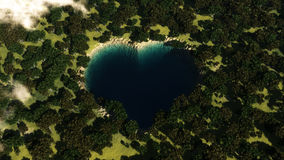Heart shape lake seen from above between trees. Royalty Free Stock Photography