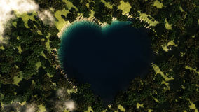 Heart shape lake seen from above between trees. Stock Photo