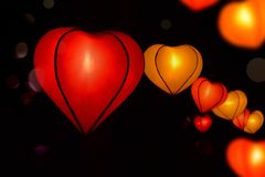 Heart shape lampion lamp lantern at park capture night time. Heart shape lampion lantern and bokeh at park at night time in black royalty free stock images