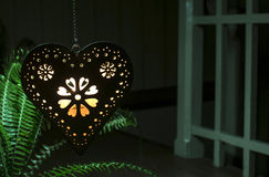 Heart shape and light from a candle Stock Photo