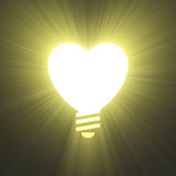 Heart shape lightbulb symbol light flare Royalty Free Stock Image