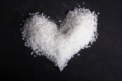 Heart shape, lined with sea salt Royalty Free Stock Images