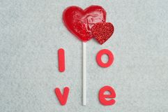 A heart shape lollipop with the word love. On a white background Royalty Free Stock Photography