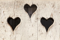 Heart shape look out on wooden door Royalty Free Stock Photos