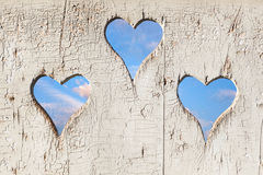 Heart shape look out on wooden door Royalty Free Stock Image