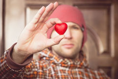 Heart shape love symbol in man hand with face on background Valentines Day romantic greeting. People relationship concept winter holiday royalty free stock image