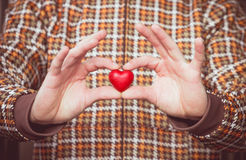 Heart shape love symbol in man hands Valentines Day. Romantic greeting people relationship concept winter holiday stock photography