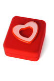 Heart shape love symbol on red jewelry box Stock Photos