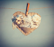 Heart shape Love symbol with white flowers decoration Valentines Day holiday gift. Hanging on pin vintage retro style wedding background design stock images