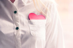 Heart shape love symbol in white shirt pocket. Valentines Day romantic greeting people relationship lifestyle feelings concept winter holiday stock photo